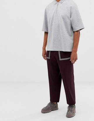 ASOS DESIGN wide leg smart pants in techy maroon with reflective tape details