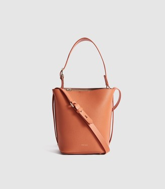 Reiss Hudson Mini - Leather Mini Bucket Bag in Orange