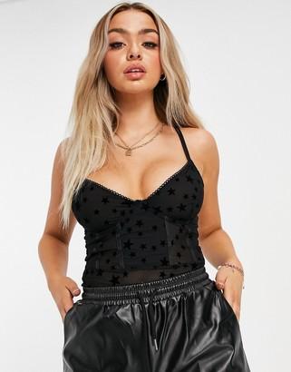 NA-KD star print mesh bodysuit in black