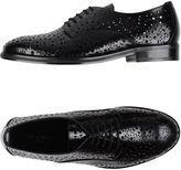 Alaia Lace-up shoes