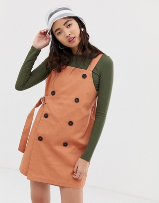 Monki dungaree dress with sided belt in peach