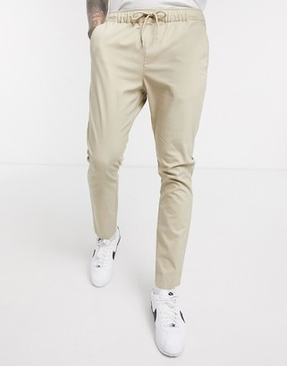 Asos DESIGN skinny chinos in putty with elastic waist