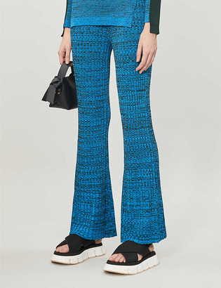Topshop Melange flared high-rise stretch-knit trousers