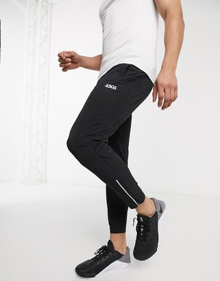 ASOS 4505 woven skinny tapered running sweatpants with reflective zip detail in black
