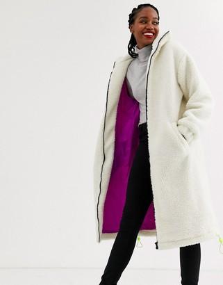 Asos Design DESIGN longline fleece coat with neon trim detail in cream