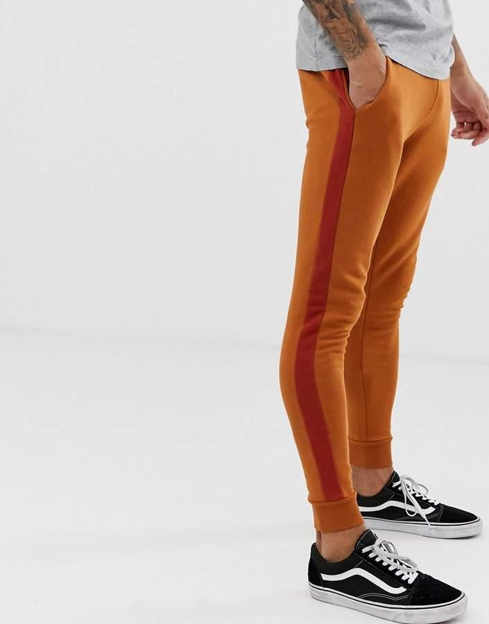Asos Design DESIGN super skinny sweatpants with side stripe in dark orange
