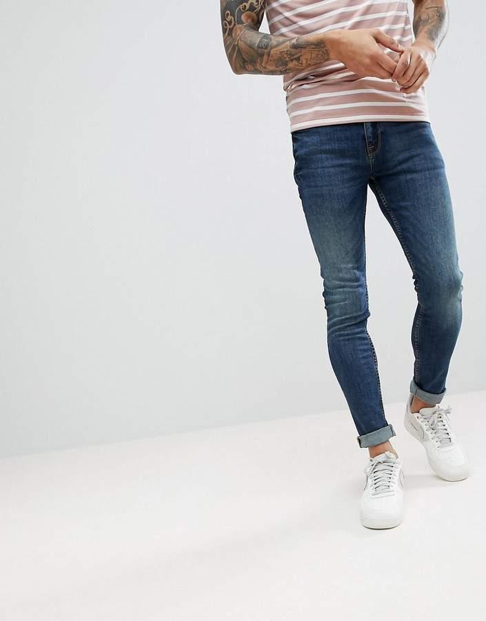Asos DESIGN Super Skinny Jeans In Vintage Mid Wash Blue