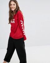 Vans Red Logo Crew Neck Sweatshirt With Checkerboard Sleeve
