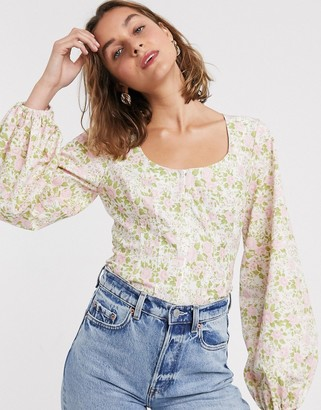 ASOS DESIGN corset detail top with bell sleeve in floral print