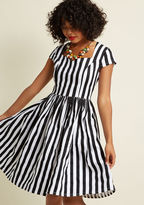 DR5394 You may want to take a seat before the black and white stripes of this Banned midi dress sweep you right off your feet! Cap sleeves frame the retro neckline of this stretch-cotton number, while sleek princess seams, hidden pockets, and an A-line cut suppo