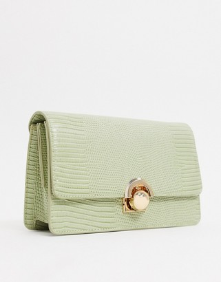 ASOS DESIGN crossbody bag with chain shoulder strap in green lizard with ball hardware