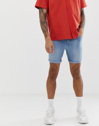 ASOS DESIGN spray on denim shorts in power stretch light wash