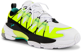 Puma Select LQD Cell Omega Lab in White & Yellow Alert | FWRD
