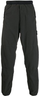 Stone Island logo-patch straight trousers