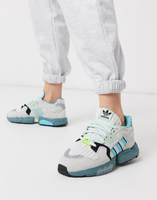 adidas ZX Torsion sneakers in white and blue