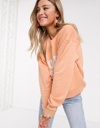In The Style x Meggan Grubb motif oversized sweat top in coral
