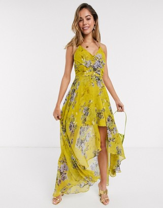 Asos DESIGN wrap front maxi dress with dipped hem in yellow based floral print