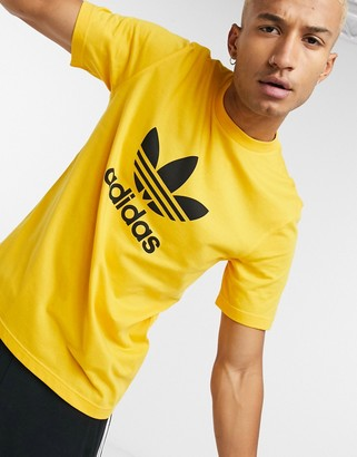 adidas T-shirt with large trefoil logo in gold