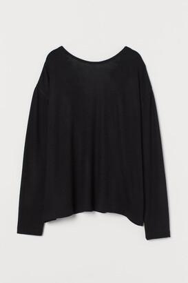 H&M Lace-trimmed V-neck jumper