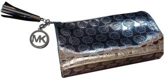 Michael Kors Silver Metal Clutch bags