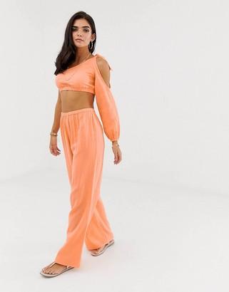 Asos Design DESIGN wide leg beach trousers in natural crinkle fabric co-ord-Orange