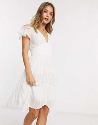 French Connection lace pleated hankerchief hem mini dress