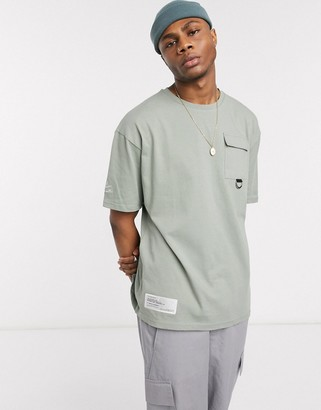 The Couture Club utility D ring box t-shirt in light green