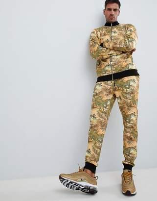 Asos Design DESIGN tracksuit track jacket/skinny sweatpants with tiger print-Yellow