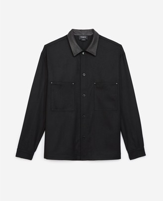 The Kooples Buttoned black wool shirt with leather collar