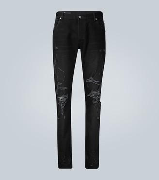 Balmain Slim-cut ripped cotton jeans