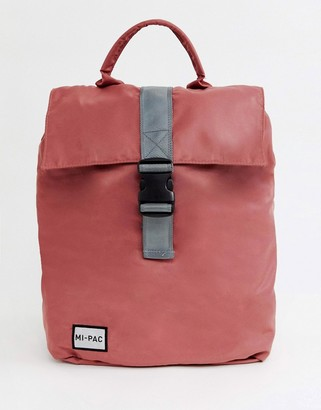 Mi-Pac nylon fold top backpack in rose pink with reflective logo