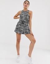 Asos Design DESIGN swing romper with belt in zebra animal print