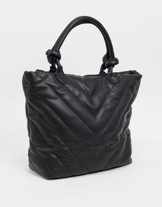 Pieces quilted tote bag in black