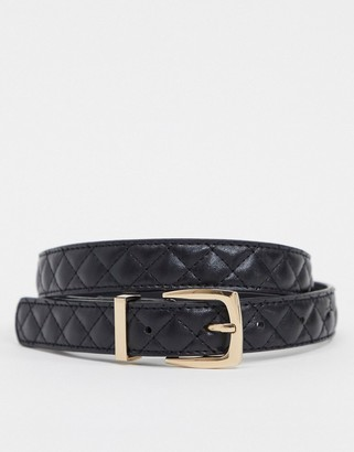 Accessorize quilted belt with gold buckle in black