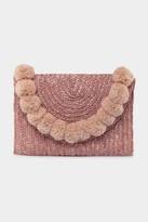 francesca's Leyla Straw Pom Clutch in Pink - Coral