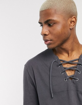 ASOS DESIGN relaxed long sleeve t-shirt with deep lace up neck