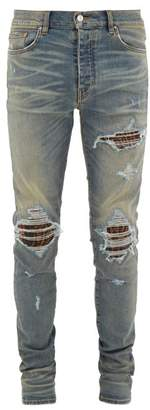 Amiri Mx1 Animal-insert Distressed Skinny-leg Jeans - Mens - Blue