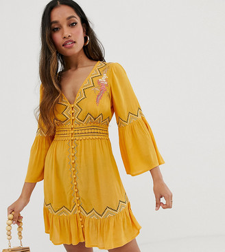 Asos DESIGN Petite lace insert mini dress with embroidery-Yellow