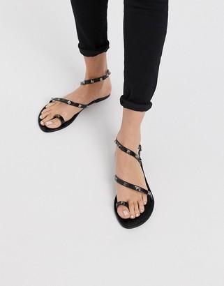 Asos DESIGN Flaunt studded jelly flat sandals in black