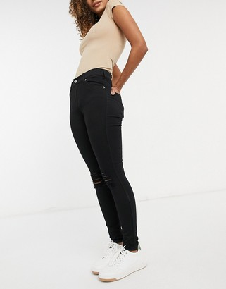 Dr. Denim Lexy skinny jeans with ripped knees in black