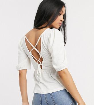 Vero Moda Petite peplum top with lace back in white