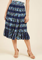 VSS170302A Sure, you could stay inside with this navy skirt, but debuting its floral stripes and fun-loving design in the sunshine is way more fun! Perfected with an elasticized waist and a ruffled hemline, this retro midi by Collectif is all the inspiration you nee