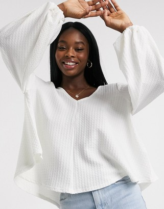 ASOS DESIGN textured smock top with v neck and blouson sleeve