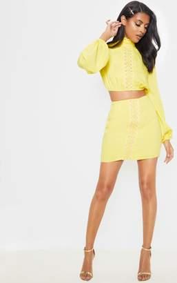 PrettyLittleThing Bright Yellow Crochet Lace Detail Frill Hem Mini Skirt