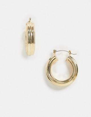 ASOS DESIGN hoop earrings in rib texture in gold tone