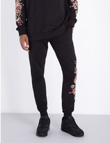 Criminal Damage Fire dragon-print cotton-jersey jogging bottoms