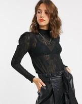 Stradivarius long sleeve top with sheer lace sleeves in black