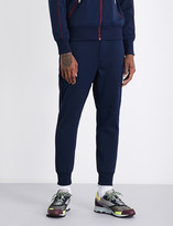 Junya Watanabe Contrast-trim skinny mid-rise jersey jogging bottoms