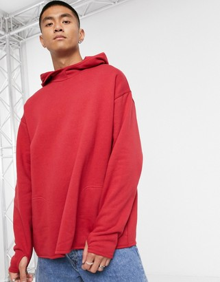 ASOS DESIGN oversized hoodie with square pockets and thumb hole detail in bright red