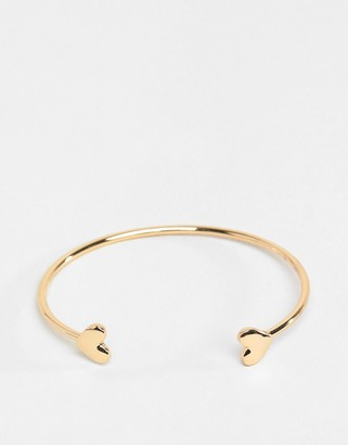 ASOS DESIGN cuff bracelet with heart detail in gold